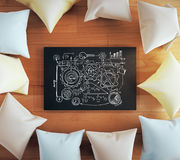 Teamwork concept pillows. Teamwork concept with gears sketch on blackboard surrounded with colorful pillows on wooden floor. 3D Rendering Royalty Free Stock Photos