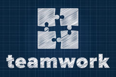 Teamwork concept with puzzle pieces on blueprint Stock Images