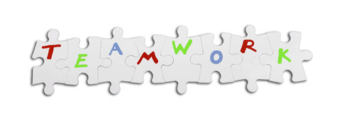 Teamwork concept. Puzzle with text as teamwork concept Stock Images