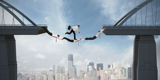 Teamwork concept. With running businessman over the bridge Royalty Free Stock Photos