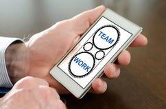 Teamwork concept on a smartphone Stock Photos