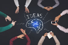 Teamwork concept - top view of six people generate ideas. Royalty Free Stock Photo