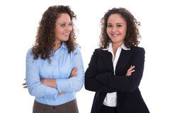 Teamwork concept: twins as businesswoman isolated over white. Royalty Free Stock Photo