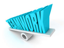 Teamwork concept word letters on balance Stock Photography