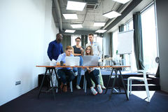 Teamwork concept.Young creative coworkers working with new startup project in modern office.Group of people analyze data Stock Image
