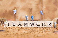 Teamwork conceptual photo. A conceptual photo with a team of workers and word, which represents teamwork Royalty Free Stock Photography