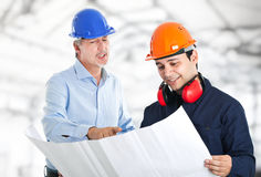 Teamwork in a construction site Royalty Free Stock Photo