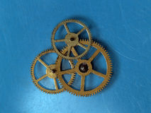 Teamwork copper cogwheels stock photo