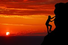 Teamwork couple hiking help each other trust assistance silhouette in mountains, sunset. Teamwork of man and woman hiker helping e. Ach other on top of mountain royalty free stock image