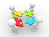 Teamwork. 3d people - men, person and a pieces of puzzle. Teamwork Royalty Free Stock Image