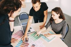 Group of diverse designers at business meeting stock images