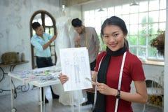 Teamwork designer concept : Fashion designer working near manneq Royalty Free Stock Photos