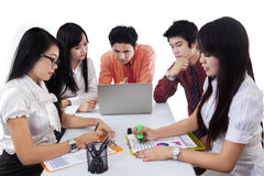 Teamwork discussing business strategy and finance Royalty Free Stock Images