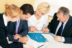 Teamwork - discussion in the office Royalty Free Stock Photography