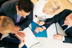 Teamwork - discussion in the office Stock Image