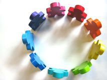Teamwork and Diversity. Colorful wooden people in a circle Royalty Free Stock Photography