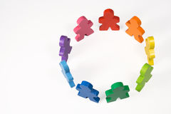 Teamwork and Diversity. Brightly colored wooden people standing in a circle.  Concepts - Teamwork, diversity, class, or group Stock Photo