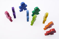 Teamwork and Diversity. Brightly-colored wooden people standing together Stock Photography