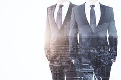 Teamwork and economy concept. Businessmen on abstract city background with sunlight and copy space. Teamwork and economy concept. Double exposure Royalty Free Stock Image