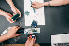 Teamwork engineering of electronic construction Royalty Free Stock Photography