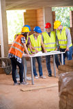 Teamwork of engineers at construction site Royalty Free Stock Image