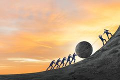 Free Teamwork Example With Business People Pushing Stone To Top Royalty Free Stock Photo - 168437405