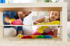 Teamwork family cleaning home with mops Stock Photos