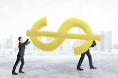 Teamwork and financial growth concept. Two businessmen carrying huge golden dollar sign on city background. Teamwork and financial growth concept. 3D Rendering Stock Photos