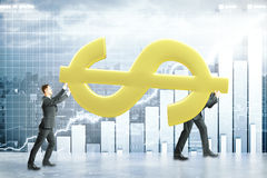 Teamwork and financial growth concept. Two businessmen carrying huge golden dollar sign on city with business chart background. Teamwork and financial growth Stock Photography