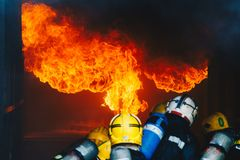 Teamwork Of Firefighters Training Stock Photo