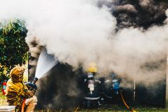 Teamwork Of Firefighters Training Royalty Free Stock Photography