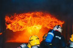 Teamwork Of Firefighters Training Royalty Free Stock Image