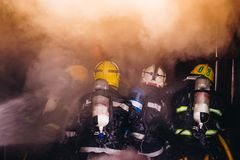 Teamwork Of Firefighters Training Stock Images