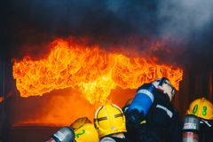 Teamwork Of Firefighters Training Stock Photography