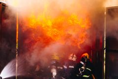 Teamwork Of Firefighters Training Royalty Free Stock Photos