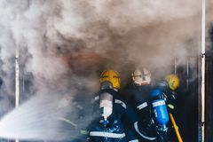 Teamwork Of Firefighters Training Royalty Free Stock Images