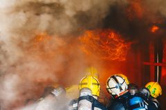 Teamwork Of Firefighters Training Royalty Free Stock Photo