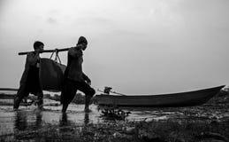 Teamwork  fisherman Royalty Free Stock Photo