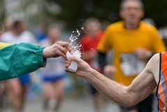 Teamwork at foot race Stock Photography