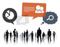 Teamwork för affärsfolk med affärssymboler Royaltyfria Bilder