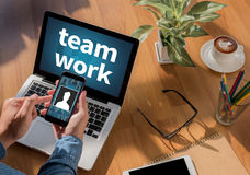 Teamwork. Freelance desktop with accessories and distance work tools, blank screen laptop computer and phone, sunglasses, coffee royalty free stock photos