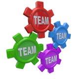 Teamwork - fyra kugghjul som tillsammans vänder som laget Royaltyfri Bild