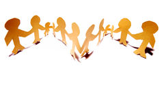 Teamwork graphic. Of paper figurines connected together Royalty Free Stock Photos