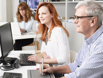 Teamwork in graphic design studio. Stock Photo