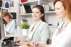 Teamwork at graphic design studio. Modern graphic designer women working with colleagues in office. Small business stock image