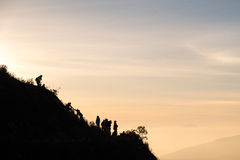 Teamwork of a group of hiker helping each other Royalty Free Stock Image