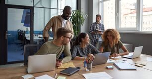 Free Teamwork. Group Of Young Happy Multicultural Business People Working Together In Modern Office, Communicating And Stock Photos - 194018523