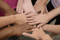 Teamwork, group putting hands together