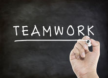 Teamwork with hand writing Stock Photo