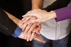 Teamwork hands. Group of employees put hands together- sign of teamwork and dedication royalty free stock photos